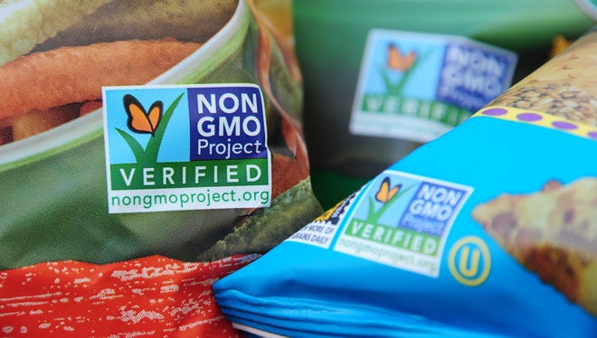 Labels on bags of snack foods indicate they are non-GMO food products in Los Angeles, California.