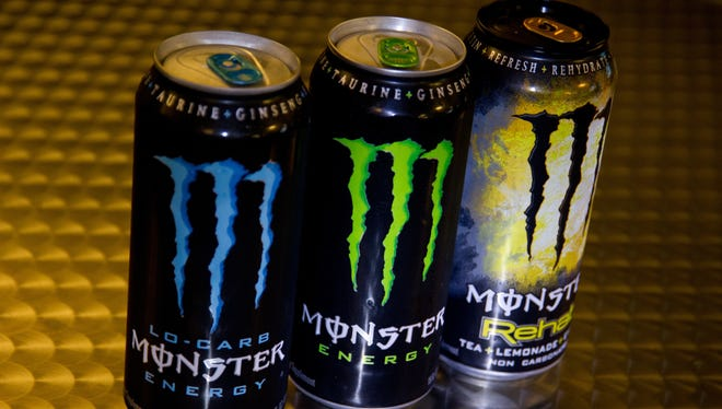 This photo illustration shows Monster Energy drinks, which have been cited in five deaths and a heart attack.