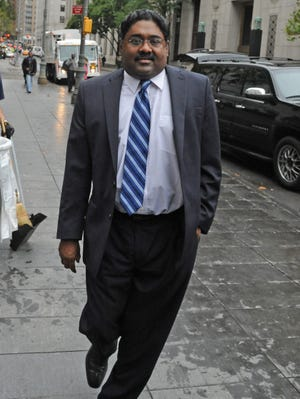 Galleon Group founder Raj Rajaratnam arrives at Manhattan federal court for sentencing on his insider-trading conviction Oct. 13, 2011.