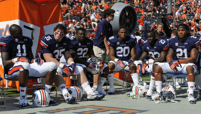 Auburn players sit on the bench watching the final moments of the 24-7 home loss to Arkansas on Oct. 6.