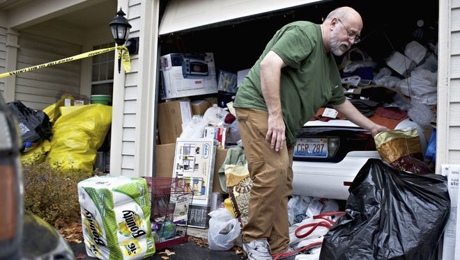 David Skeberdis, 57, worked Monday on cleaning out the garage at his home in Aurora, Ill., which officials condemned as uninhabitable. Friday, crews began removing an estimated 300 birds living in the two-story townhouse. Skeberdis, a computer technician, said he planned to change his life.