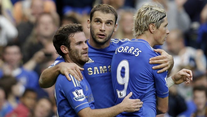 Chelsea's Branislav Ivanovic, center, celebrates his goal against Norwich City with teammates Fernando Torres, right, and Juan Mata.