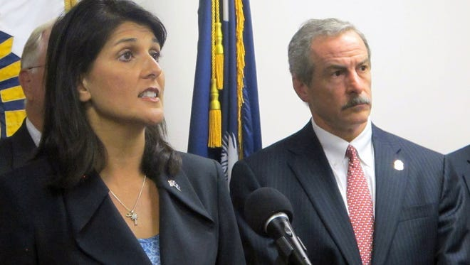 South Carolina Gov. Nikki Haley and Chief Mark Keel of the South Carolina Law Enforcement Division answer questions at a news conference in Columbia S.C. on Friday.