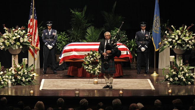 Bagpiper Tom Parliman plays at the end of funeral services for former Democratic U.S. Senator and three-time presidential candidate George McGovern at the Washington Pavilion of Arts and Sciences in Sioux Falls, S.D.