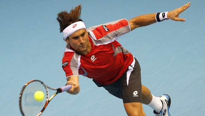 Spain's David Ferrer returns a ball to Spain's Nicolas Almagro during the Open 500 Valencia at the Agora space in Valencia on Friday.