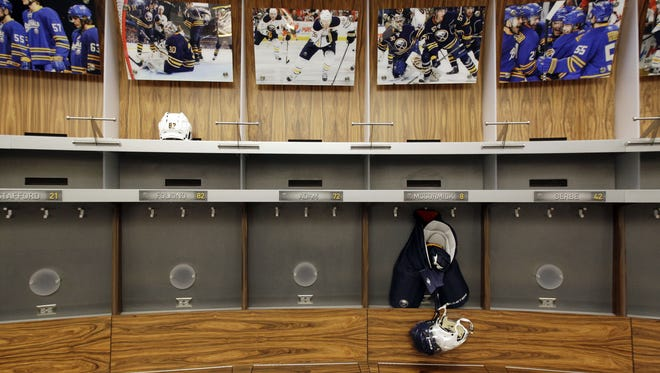 The Buffalo Sabres' locker room remains empty because of the lockout.