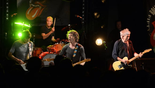 PARIS, FRANCE - OCTOBER 25: (EXCLUSIVE COVERAGE) (L-R) Ronnie Wood, Charlie Watts, Mick Jagger and Keith Richards of The Rolling Stones perform at a secret club gig for 600 lucky fans as the band warm up for their 4 dates in London and New York next month. Fans paid only $20 for tickets at La Trabendo Rock Club on October 25, 2012 in Paris, France.  Photo by Dave J Hogan, Getty Images