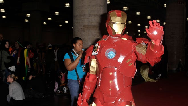 A Comic Con attendee wears an Iron Man costume at the Javits Center in New York City on Oct. 12.