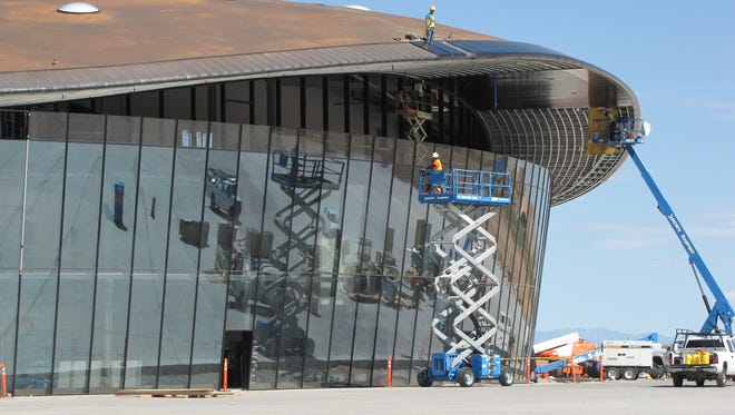 N.M. Spaceport yet to draw manned flights, tourists: A 2009 photo shows the terminal and hangar facility at Spaceport America, in the desert about 30 miles from Truth or Consequences, under construction.