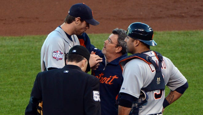 Doug Fister talks to trainer Kevin Rand after he was hit in the head by a line drive during the second inning of Game 2.