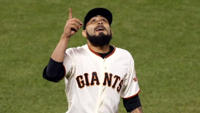 San Francisco Giants pitcher Sergio Romo (54) reacts after defeating the Detroit Tigers 2-0 in game two of the 2012 World Series at AT&T Park.