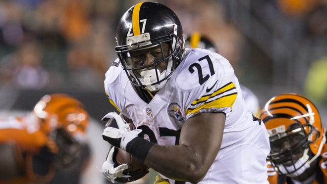 Steelers running back Jonathan Dwyer (27) carries the ball against the Bengals at Paul Brown Stadium, where he rushed for 122 yards last week.