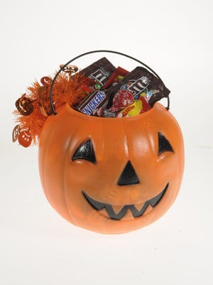 Some Halloween candies contribute to tooth decay more than others, dentists say. Plain chocolate and sugar-free gum are among the better options.