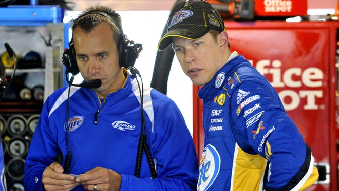 Brad Keselowski, right, and crew chief Paul Wolfe will need another stunning finish to retain their points lead Sunday. Keselowski starts 32nd at Martinsville Speedway.