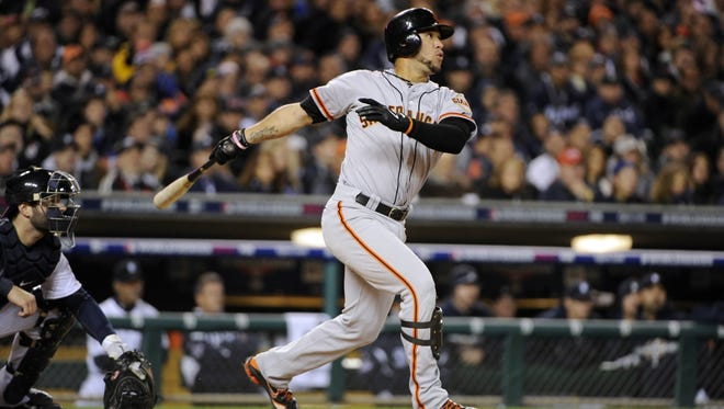 Gregor Blanco hits a RBI triple against in the second inning of Game 3 to give the Giants a 1-0 lead.