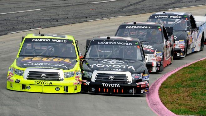 Denny Hamlin (right) passes Matt Crafton for the lead at Martinsville Speedway on Saturday.