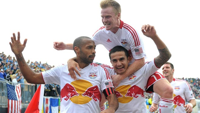 Thierry Henry celebrates with teammates after scoring in the Red Bulls' 3-0 win against the Philadelphia Union.