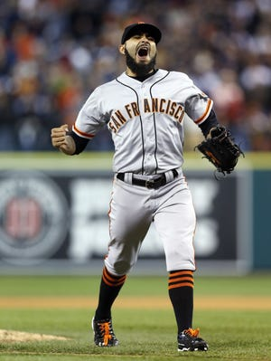 Giants closer Sergio Romo celebrates after completing a 2-0 victory over the Tigers in Game 3 of the World Series Saturday
