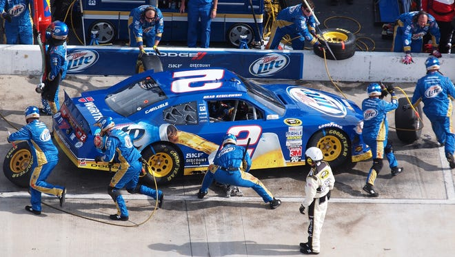 Brad Keselowski pits during the NASCAR Sprint Cup Series auto race at Martinsville Speedway.