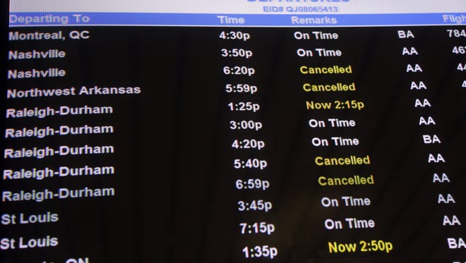 The departures board at the American Airlines terminal at LaGuardia airport shows  cancellations, Sunday, Oct. 28 in New York.