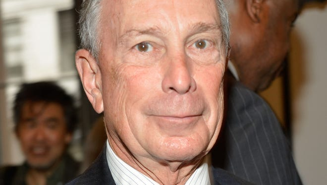 New York Mayor Michael Bloomberg, the nation's 10th richest man, says he will spend up to $15 million to help elect moderate congressional candidates who back his views on education, gun control and efforts to legalize gay marriage.