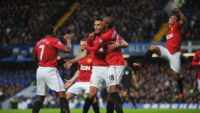 Robin van Persie is congratulated by teammates after scoring for Manchester United on Sunday.