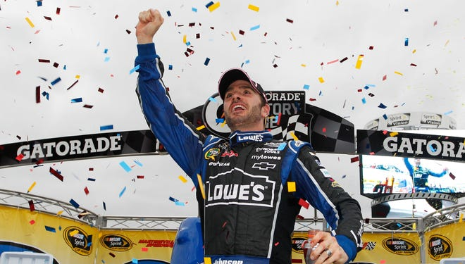 Jimmie Johnson pumps his fist after his seventh career win at Martinsville.