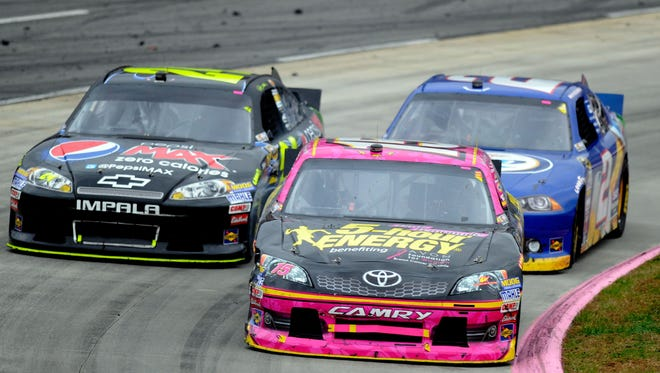 Clint Bowyer (front right) and Jeff Gordon (left) got tangled late in the race.