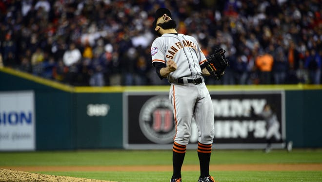 Giants pitcher Sergio Romo reacts after striking out Miguel Cabrera to win the World Series.
