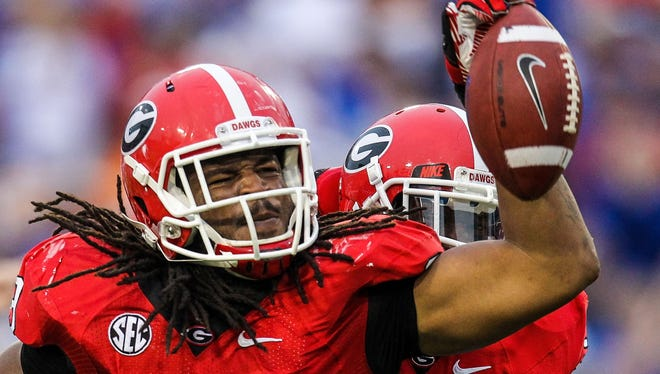 Georgia linebacker Jarvis Jones celebrates a second-half fumble recovery in the win against then-No.3 Florida.