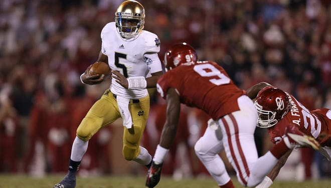 Everett Golson's steady play at quarterback helped Notre Dame stay unbeaten with a win at Oklahoma.