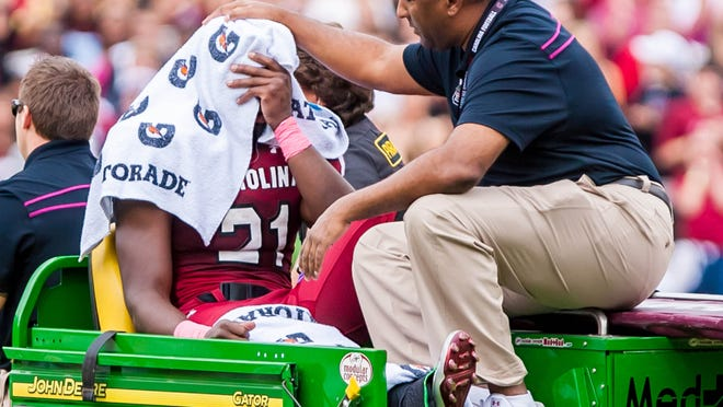 South Carolina coach Steve Spurrier said Marcus Lattimore may not be able to return from his knee injury until 2014.