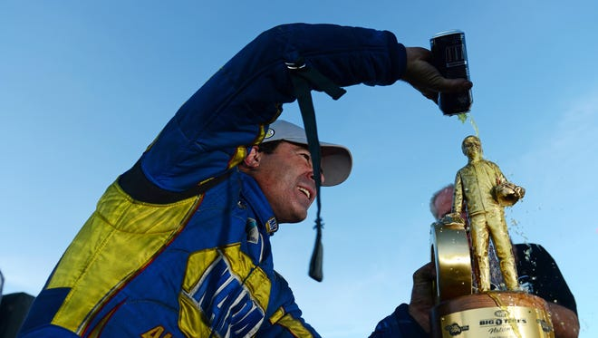Ron Capps celebrates after winning the Funny Car event at the Big O Tires NHRA Nationals Sunday at The Strip in Las Vegas.