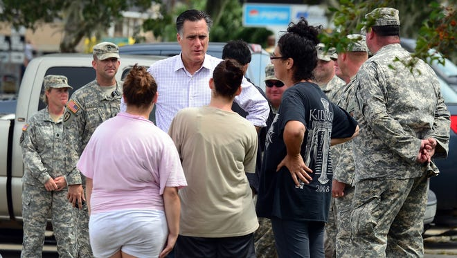 Mitt Romney met with storm-affected residents from Hurricane Isaac in Louisiana on Aug. 31.