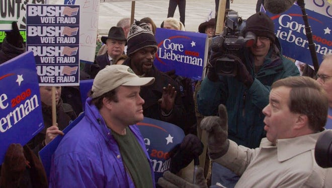 Supporters of both George W. Bush and Al Gore demonstrate Dec. 11, 2000, outside the Supreme Court in Washington. The next day, the court issued its decision on Bush v. Gore, settling the disputed 2000 election and ushering Bush into the White House.