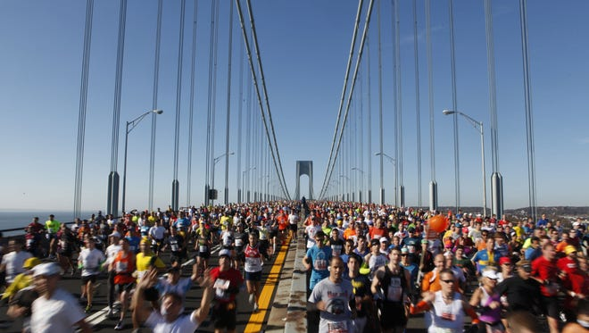 Runners cross the Verrazano-Narrows Bridge at the start of the New York City Marathon on Nov. 6, 2011 in New York. With the storm raging in New York, race organizers say time will help them prepare for Sunday's start.