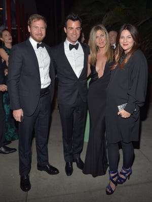 Art consultant Will Kopelman and actors Justin Theroux, Jennifer Aniston and Drew Barrymore attend LACMA 2012 Art + Film Gala on Saturday in Los Angeles.