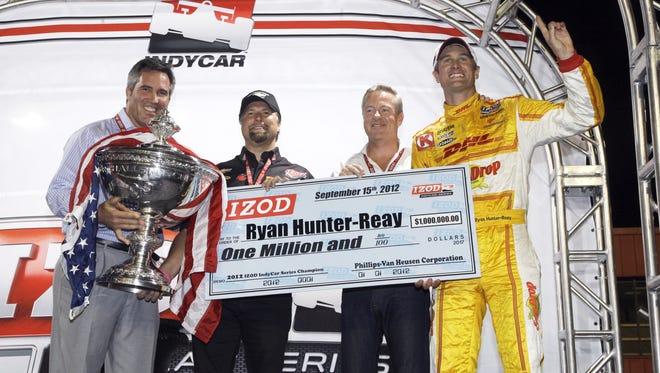 Former IndyCar CEO Randy Bernard (left) celebrates with series champion Ryan Hunter-Reay last month.