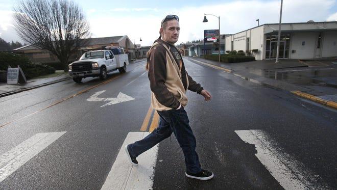 Mayor Eric Strawn crosses the street on Feb. 25 in Tenino, Wash.