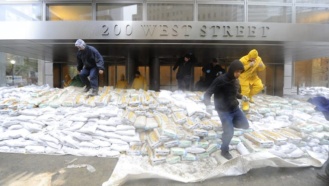 Workers prepare to sandbag in a building in Battery Park near the Hudson River  in New York. Two hospitals closed as Hurricane Sandy threatened to disrupt services.