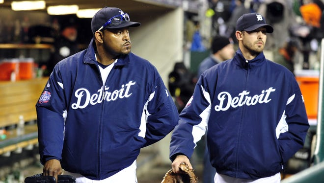 Re-signing closer Jose Valverde, left, watching the Giants celebrate Sunday, could help the Tigers next season.