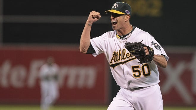 Oakland A's closer Grant Balfour celebrates after winning Game 3 of the 2012 ALDS against the Detroit Tigers.