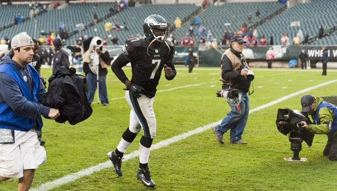Eagles quarterback Michael Vick (7) runs off the field after losing to the Falcons 30-17 at Lincoln Financial Field.