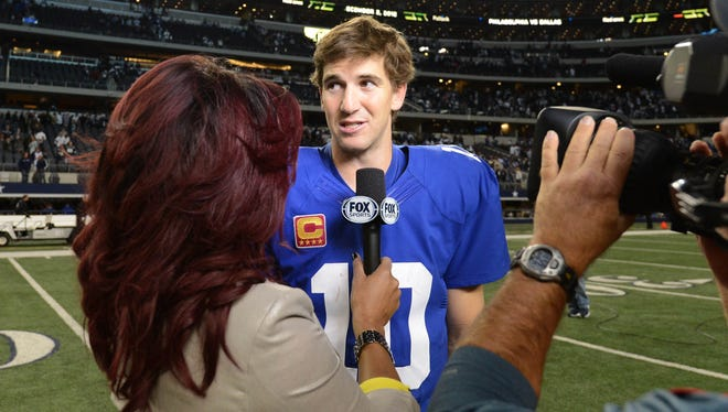 Fox's Pam Oliver interviews New York Giants quarterback Eli Manning after the team's win against the Dallas Cowboys on Sunday, which drew a big TV rating.