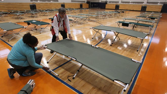Red Cross workers set up cots inside West Philadelphia High School on Oct. 28. The Philadelphia school is being used as one of the city's shelters for residents as Hurricane Sandy makes its way up the Atlantic.