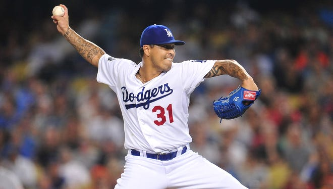 Los Angeles Dodgers relief pitcher Brandon League (31) pitches in the ninth inning against the San Francisco Giants at Dodger Stadium.
