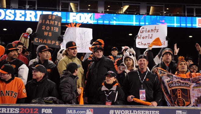 San Francisco Giants fans cheer after Game 4 of the 2012 World Series against the Detroit Tigers at Comerica Park.  The Giants won 4-3 to sweep the series.