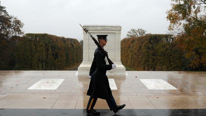 Before the cemetery was closed for the day, Spc. Brett Hyde, Tomb Sentinel, 3d U.S. Infantry Regiment (The Old Guard), keeps guard over the Tomb of the Unknown Soldier as Hurricane Sandy approaches.