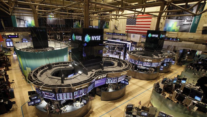 The floor of the New York Stock Exchange is empty of traders for the second straight day Oct. 30, 2012.