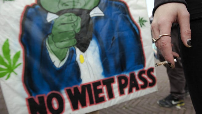 A woman holds a marijuana joint in Amsterdam during an April protest against a government plan to stop foreigners from buying marijuana in the Netherlands.